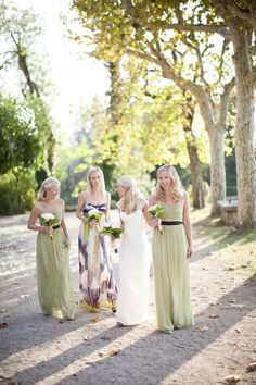Green bridesmaid dresses with purple sashes, Photography by www.smallpigart.se/