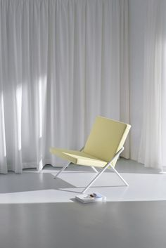 Week of December 4, 2017 - Huskdesignblog | Euclides by Loehr | design furniture | minimal furniture | minimal decor | coated bench | coated seating | minimal armchair | minimal bench | yellow armchair | beige armchair | tubular structure | German design | seatings | modern furniture | contemporary furniture | yellowish furniture | white curtains | white floor