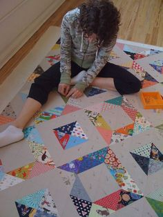 My friend Noelle stopped in the shop to discuss her upcoming class and shot some pictures of me pinning Roan's quilt. Another Half Square Triangle for the upcoming class at Fabric Crush. Ove…