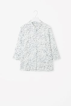 COS image 2 of Embossed A-line shirt in White