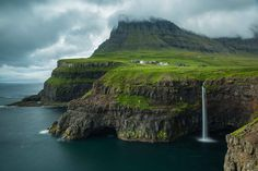 2015 National Geographic Photo Contest - The Atlantic Living on the edge, Faroe Islands. Right away after landing on the island I drove up to these incredible cliffs. The conditions were not favorable, there was so much fog that you couldn't see any of the mountains in the background. But since I was so excited to be in a place so wonderful I wanted to wait. I had plenty of time to explore the location and enjoy the place and at the end the magic happened