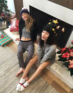 Even on Christmas morning they still look like supermodels! Bella Hadid shared this cute picture of her and her sister Gigi posing near the fireplace on Dec. 25, 2015.