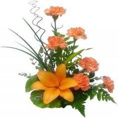 Un lily, seis claveles al tono y follaje de helechos