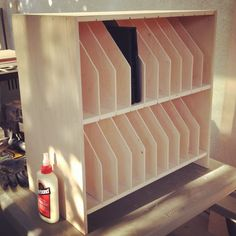 iPad storage shelf diy:http://smpsipadprogram.blogspot.com/2012/08/diy-ipad-storage-cabinet.html