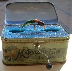 Mermaid tin - wonder if it could be done in an Altoid tin