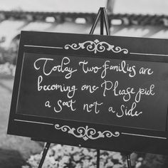 A unique sign invited guests to choose their seat for the ceremony. Photo Credit: Civic Photos
