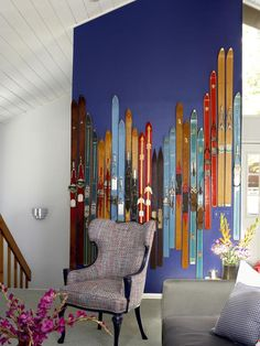 Decorate With Upcycled Wall Art, Shelves and Storage: Designers Cortney and Bob Novogratz remodeled legendary skateboarder Tony Hawk mountain retreat. They lined the feature wall with old skis to add a pop of color and staggered the skis placement to mimic the mountains outside the window. From DIYnetwork.com