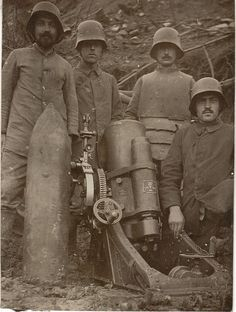 Grabenpanzer    A German crew pose by what looks like a 170mm minenwerfer. The soldier in the body armor may be a forward artillery observer for this mortar unit.  WW 1.