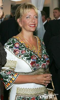 Ex 1st Lady of Ukraine wearing national embroidery.  Also wearing her wedding ring on her right hand, which is Ukrainian custom.
