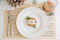 Natural Christmas Tablescape: vintage Christmas sheet music placemat idea.....great idea