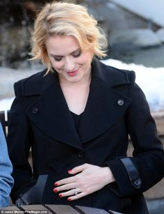 Oh baby: Evan Rachel Wood, who announced her pregnancy earlier this month, cradled her baby bump at Sundance Film Festival on Tuesday
