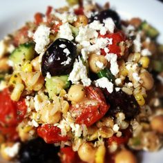 Brown Rice Greek Salad - The Lemon Bowl. Brown rice is given a Greek twist with roasted cherry tomatoes, crunchy cucumbers, creamy feta and kalamata olives.