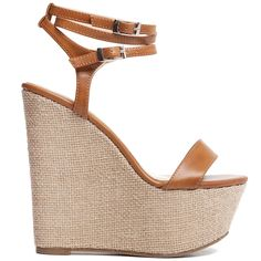 Tobacco high-heeled platform with textile sole and straps that die around the ankle.
