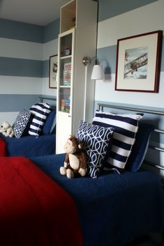 """these are GREAT COLORS!! I love the greyish-blue stripes on the walls! and I love that it's """"red, white and blue"""" yet not too patriotic looking. I like how it's set up for 2 boys."""