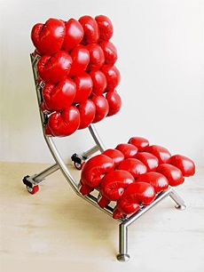 'argument chair' is made of red leather boxing gloves