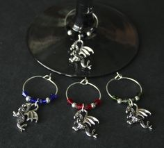 DRAGON WINE CHARMS-This is a set of 4 dragon wine charms. Charms are 3D and nicely detailed.  Crystal beads in colors of ruby red, black, royal blue and dark green were used, along with shiny silver accents.  Feel free to message me with colors for you own custom set.