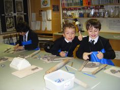 Henry P and Alex making their clay Christmas Tree decorations