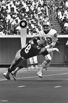 Linebacker Jack Lambert #58 of the Pittsburgh Steelers tackles wide receiver Mike Renfro #82 of the Houston OIlers on September 7, 1980, at Three Rivers Stadium in Pittsburgh, Pennsylvania.