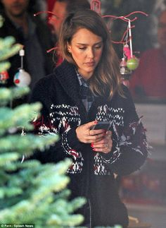 Phone check: After snapping pictures of her kids, Jessica checked something on her mobile device