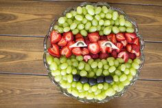 Ninja Turtle Birthday Party: ninja head fruit plate, made out of green grapes, strawberries, apple slices and jumbo olives.