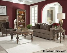 Mixing burgundy or red wine decor with gray for a sophisticated look. This gray and wine decor living room featuring Ambella Home tables is a great example.  EuroLuxHome.com