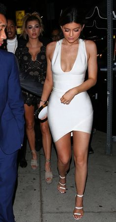 Kylie Jenner wears a white body-con dress with white heels