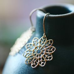 nice styling on vessel || anna - gold filigree earrings by elephantine, via Etsy.
