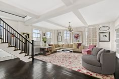 Celebrity home interiors - Tour Seth Meyers's New $7.5 Million Duplex in Greenwich Village. Gorgeous living room with boxed beamed ceiling.