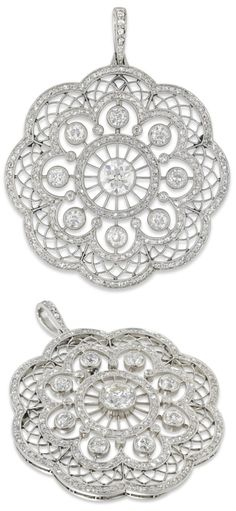 An Edwardian circular diamond cluster pendant, the central old brilliant-cut diamond estimated to weigh one carat, millegrain-set within an intricately pierced panel of floral design, set throughout with old- and rose-cut diamonds estimated to weigh a total of 3.5cts, circa 1910. Gross weight 15.6 grams. Via Bentley & Skinner.