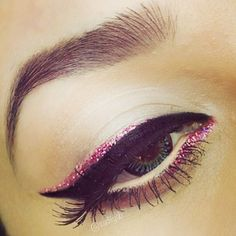 Pink glitter and black liner.
