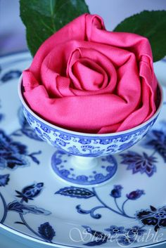 Complement your rose party centerpieces in any season, for any occasion! StoneGable: Rosette Napkin Fold Tutorial