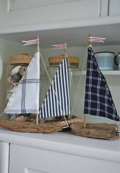 use driftwood branch from upstairs to make boats with fabric in their colors