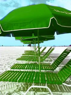 Green beach chair and umbrella.