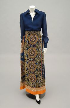 Woman's ensemble: blouse and skirt | Designed by Tina Leser (American, 1910-1986) | United States, 1966 | Blouse: silk organdie. Skirt: printed silk organdie with gold metallic thread couching, metallic lace, and orange silk satin | Philadelphia Museum of Art