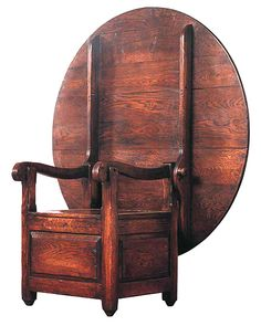 Pilgrim hutch table.  Folded from a chair to a table.