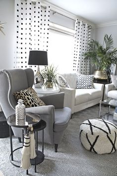 neutral and eclectic living room with lots of black and white accents