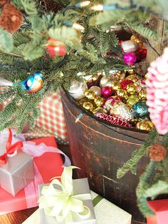 An Overflow of Ornaments (like ornament moss)  Great idea instead of a tree skirt)