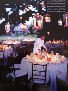 outside party with candles on the tables and hanging from trees. #marthastewartweddings