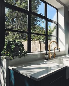 so much for the love on yesterday's photo ❤️ Our kitchen area has become one of my favourite spots in the house. The mix of Hague Blue shaker doors, quartz worktops, brushed gold taps, black aluminium windows, micro-cement walls and Black Kitchen Cabinets, Black Kitchens, Kitchen Black, White Cabinets, Crittal Doors, Lily Pebbles, One Wall Kitchen, Kitchen Taps, Aluminium Windows
