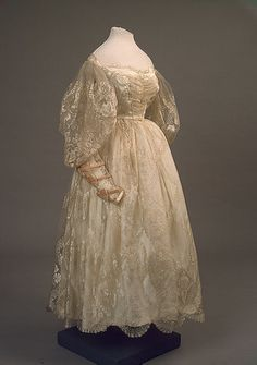 Evening dress, 1830's, Russian. From the State Hermitage Museum. Lovely sheer lace sleeves and layers, triple bow on forearm.