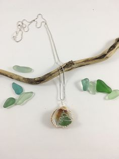 Aqua Sea Glass and Shell Pendant on sterling silver chain with freshwater pearl. $45. Genuine sea glass is wire wrapped in sterling silver wire and combined with a clam shell in this one of a kind pendant. This pendant would be perfect for any beach loving or mermaid aspiring person. Head to the link to claim it now. #seaglass #seaglassjewelry #beachwedding #wirewrappedjewelry Beach Jewelry, Diy Jewelry, Handmade Jewelry, Jewelry Necklaces, Bracelets, Sea Glass Necklace, Sea Glass Jewelry, Pendant Jewelry, Sterling Jewelry