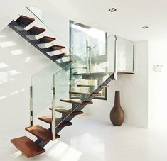 modern-staircase-design-with-wooden-floating-steps-glass-railing-design-ideas. modern-staircase-design-with-wooden-floating-steps-glass-railing-design-ideas. Steel Stair Railing, Stair Railing Design, Metal Stairs, Staircase Railings, Railing Ideas, Staircase Ideas, Spiral Staircases, Painted Stairs, Glass Stairs