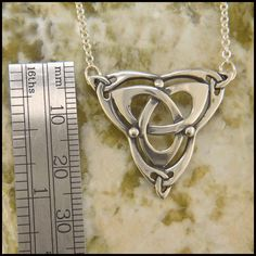 Sterling silver Celtic triquetra pendant with an attached chain.