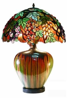 Warehouse of Tiffany Style Grape Table Lamp, Bronze This item by Warehouse of Tiffany is offered with green/amber/purple glass. Comes in a bronze Brown Table Lamps, Ceramic Base, Room Lamp, Lamp, Tiffany Style Table Lamps, Luxury Lamps, Warehouse Of Tiffany, Tiffany Style Lamp, Glass Art