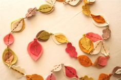 leaf garland - like the spring-y colors, the layering of some leaves (and not others), and the stitched-togetherness