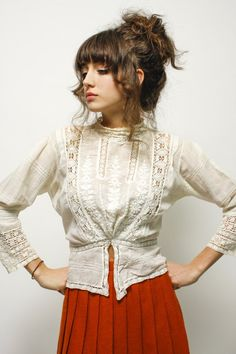 Extremely delicate one of a kind vintage Victorian blouse! Truly unique featuring a high neck, lace and embroidered front, with a button back. There is a small stain pictured underneath the left armpi
