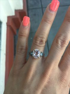 My Ring.  Cushion cut peach Morganite surrounded by Vanilla  diamonds then two side pear-cut Sea Blue Aquamarine stones surrounded by Chocolate Diamonds on a 14k Strawberry Gold band. #morganitering #morganite #engagementring #alternativeengagementring #engaged #cushioncut #morganiteengagementring #aquamarine #chocolatediamonds