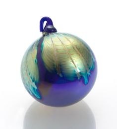 """Aurora Borealis"" #art glass #ornament by Jennifer Smith, John P. Gilvey, Michael Benzer and Wendy Gilvey. Like aurora dancing across a night sky, feathers of shimmering, iridescent glass melt into an expanse of midnight blue. An Artful Home exclusive."