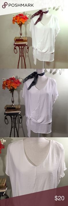 "ANA white blouse, size L, short sleeves ANA white blouse, size L, short sleeves, polyester, wear to work with dress pants or casual with jeans or shorts! Very pretty and classic white top. In great condition! Measurements are: 22"" across chest armpit to armpit, 26"" from back of neck to hem. a.n.a Tops Blouses"