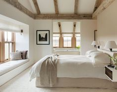 "The master bedroom is scaled for two, and connects the couple with the surrounding land. The custom slip covered bed and natural lines ""are never supposed to look perfect,"" says Walsh. ""The messier the better."""
